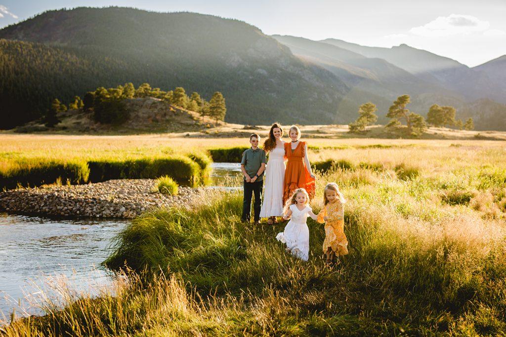 Estes Park Photographer photo of little girls running in a field