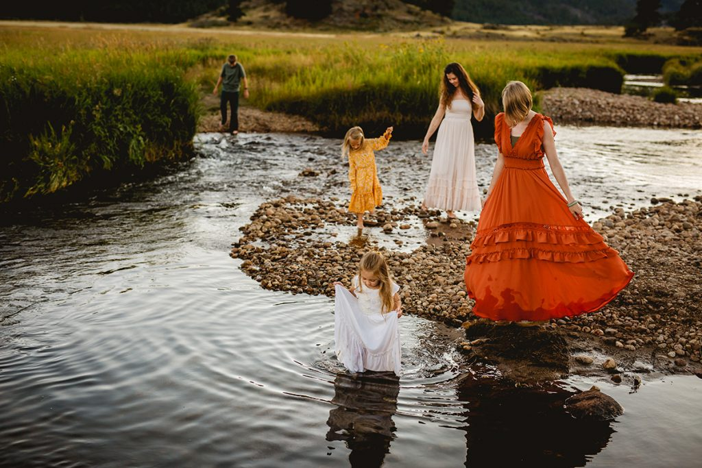 A family plays in the water during their Estes Park Colorado photo shoot