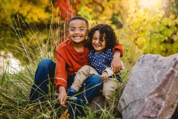two brothers play together during their fall family photo session at a Fort Collins natural area